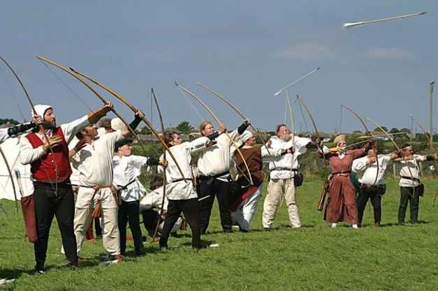 Photo taken at the Battleof Camlann 7th August 2004 in Tintagel Demonstration of expert bowmen firing their arrows into a very strong wind