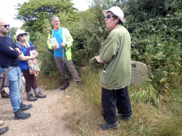Cassandra speaking to the group about C.A.S.P.N at the entrance of the Merry Maidens stone circle